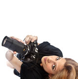 Photographer girl. A photographer girl with a zoom lens isolated on white background Royalty Free Stock Photo
