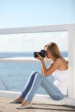 Photographer girl. On the pier royalty free stock image
