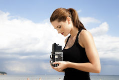 Photographer girl. On the beach Stock Photography