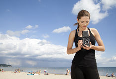 Photographer girl. On the beach Stock Image