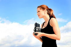 Photographer girl. On background of the sky royalty free stock photo
