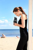 Photographer girl. On the beach Royalty Free Stock Image