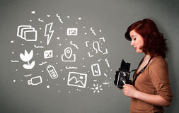 Photographer girl capturing white photography icons and symbols Royalty Free Stock Images