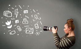 Photographer girl capturing white photography icons and symbols Royalty Free Stock Photos