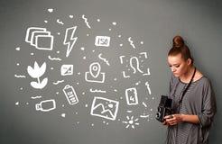 Photographer girl capturing white photography icons and symbols Stock Photo