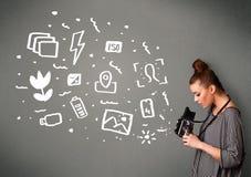 Photographer girl capturing white photography icons and symbols Stock Photos