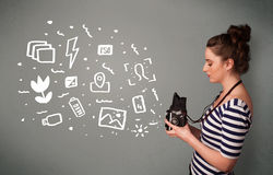 Photographer girl capturing white photography icons and symbols Royalty Free Stock Image