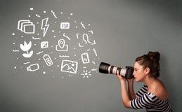 Photographer girl capturing white photography icons and symbols Royalty Free Stock Photo