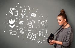 Photographer girl capturing white photography icons and symbols Stock Photography