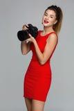 Photographer girl with dslr camera Stock Photo