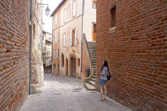 Photographer girl in a lovely street in Albi Royalty Free Stock Photos