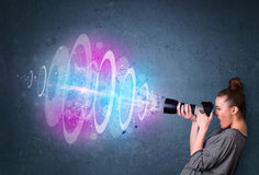 Photographer girl making photos with powerful light beam Royalty Free Stock Photo