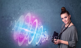 Photographer girl making photos with powerful light beam Royalty Free Stock Image