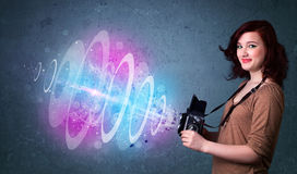 Photographer girl making photos with powerful light beam Royalty Free Stock Images
