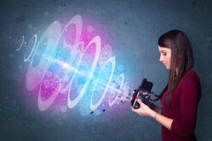 Photographer girl making photos with powerful light beam Stock Images