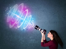 Photographer girl making photos with powerful light beam Royalty Free Stock Photos