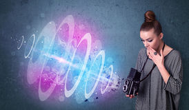 Photographer girl making photos with powerful light beam Royalty Free Stock Photography