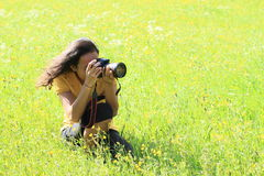 Photographer girl on meadow Royalty Free Stock Photography