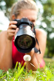 Photographer girl in nature Stock Photo