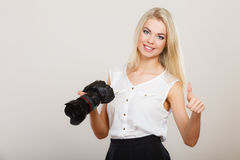 Photographer girl shooting images Royalty Free Stock Image
