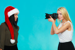 Photographer girl shooting images Royalty Free Stock Photography