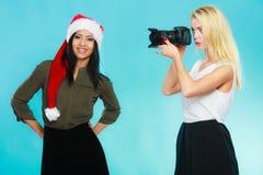 Photographer girl shooting images Royalty Free Stock Photos