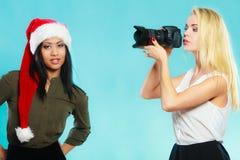 Photographer girl shooting images Stock Photos