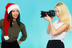 Photographer girl shooting images Royalty Free Stock Photo