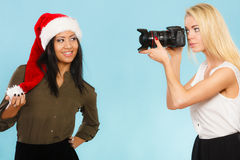 Photographer girl shooting images Stock Images