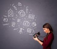 Photographer girl shooting photography icons. Young photographer girl shooting photography icons Royalty Free Stock Photography