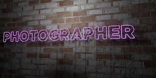 PHOTOGRAPHER - Glowing Neon Sign on stonework wall - 3D rendered royalty free stock illustration Royalty Free Stock Photography