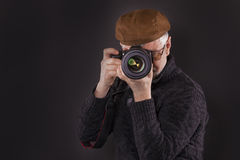 Photographer. Guy in his fifties with digital camera Royalty Free Stock Images