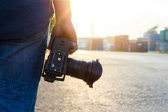 photographer, hand hold camera stock images