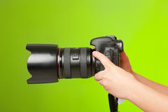 Photographer hands with camera Royalty Free Stock Photography