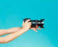 Photographer hands holding camera shooting images Royalty Free Stock Photos