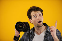 Photographer has an idea or inspiration. On yellow background Royalty Free Stock Photography