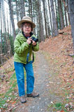 Photographer on a hike Royalty Free Stock Images