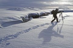 Photographer and his shadow on the snow Royalty Free Stock Images
