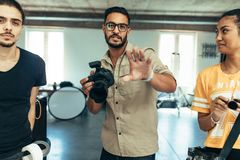 Photographer with his team during a photo shoot in a studio stock photos