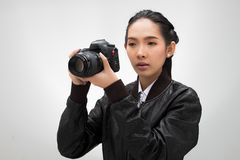 Photographer hold camera with external flash point royalty free stock photos