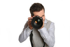 Photographer holding big camera Royalty Free Stock Photo