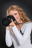 Photographer holding camara Stock Photo