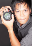 Photographer holding a camera Royalty Free Stock Image