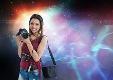 Photographer holding camera  against galaxy background. Digital composite of Photographer holding camera  against galaxy background Royalty Free Stock Photography