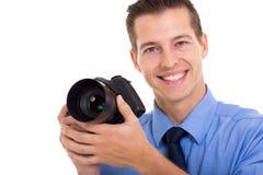 Photographer holding camera Royalty Free Stock Image