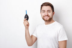 Photographer holding camera cleaning vacuum pump.  air blower pu Royalty Free Stock Images