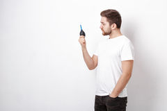 Photographer holding camera cleaning vacuum pump.  air blower pu Royalty Free Stock Image