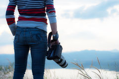 Photographer holding camera, close-up. Back view, Selective focu Royalty Free Stock Images