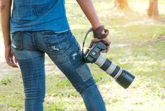 Photographer holding camera. For taking many pictures Royalty Free Stock Photos