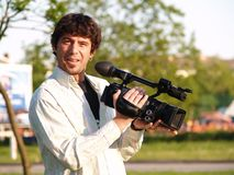 Photographer holding digital camera Royalty Free Stock Images
